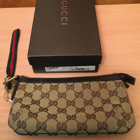 5b85e1738ef Gucci Handbags - Authentic Gucci Wristlet Maxi Wallet JoliCoe Brown